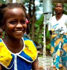 The joy of having clean water and the Living Water of Jesus.  (Image, caption courtesy LWI/ANS)