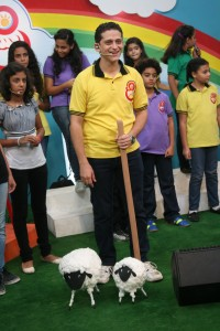 SAT-7 host with sheep on With Jesus show. (SAT-7 photo)
