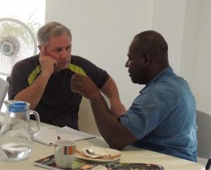 Dr. Steve Edmondson speaks with Haiti's former national director of finance.  (Image courtesy Starfysh)