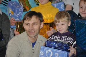 Pastor Sergey Aleev (Baptist Bible Church of Irkutsk, Russia) distributes gifts during Gift of Hope distribution last year.