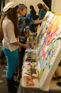 Many Millennials connect with the Gospel through art, as shown in this picture from Urbana 12.  (Image courtesy InterVarsity Arts Ministry)